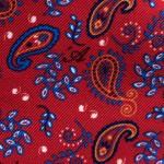 Dettaglio Microfantasia cachemire su base Rosso Traffico con monogramma 'A