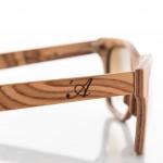 Stealth -Occhiale in legno – dettaglio strati del frontale e logo